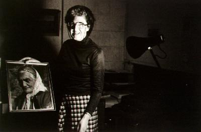 Mrs Anne Marriott holding portrait of Guide Minnie