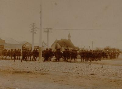 troops following band turning from Fenton Street into Haupapa Street - St Luke's church on left - boer war period ?