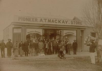 Pioneer Store (A.T Mackay) north east corner Arawa/Tutanekai Streets site of first Rotorua store built and run by Wylie, Guide Sophia centre ?, Cath father 2nd from left ?