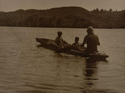 Adult and two children in canoe