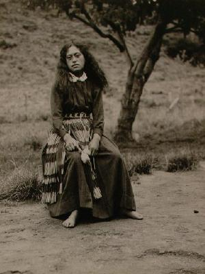 Young woman with piupiu and poi
