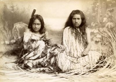 Two young girls sitting