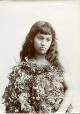 Young girl in a feather cloak