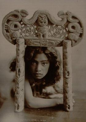 Young girl framed in miniature door way