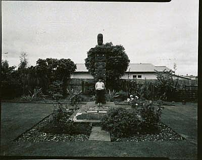 Tene Waitere memorial at Guide Rangi's house, with Emily Schuster's grand daughter