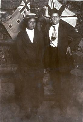 Post card of a studio portrait featuring a young Maori couple
