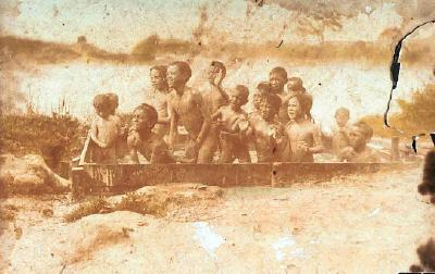 Young children in family bath Ngapuna, C Pohe's grandmother's side, Enoka Tama Pohe (father of C Pohe) at rear with hand in air, Tita Loftly below Enoka and to right Enoka and Tita 1st cousins